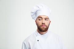 Portret zadumany męski szefa kuchni kucharz patrzeje daleko od Fotografia Stock