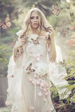 Portrhe young lady among the flying butterflies Royalty Free Stock Images