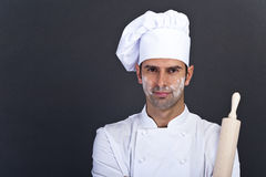 Portriat of the cook. With roll over dark background Stock Image