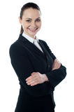 Portriat of corporate lady, smiling. Portriat of corporate lady posing with folded arms isolated over white, smiling Stock Images
