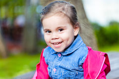 Portriat of cute little smilling girl. Portriat of cute little smilling child girl in a park Stock Images