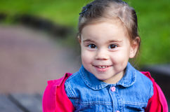 Portriat of cute little smilling girl. Portriat of cute little smilling child girl in a park Royalty Free Stock Photo