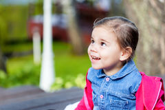 Portriat of cute little smilling girl. Portriat of cute little smilling child girl in a park Stock Photography