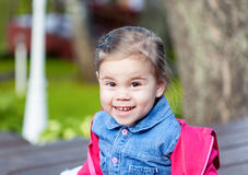 Portriat of cute little smilling girl. Portriat of cute little smilling child girl in a park Royalty Free Stock Image