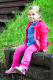 Portriat of cute little smilling girl. Portriat of cute little smilling child girl in a park Royalty Free Stock Images
