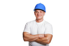 Portriat of man with helmet, worker white shirt. Crossed arms. Stock Photo