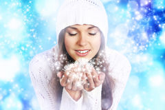 Free Portriat Of A Young Woman In A Hoodie Holding Snow Stock Image - 35805261