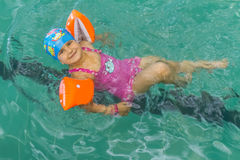 Portriat of young happy caucasian child girl swimming Stock Photos