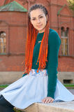 Portriat of young woman with orange braids. Girl with long red h royalty free stock images