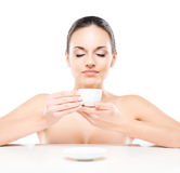 Portrit of a young and naked woman with a cup of coffee Royalty Free Stock Photos
