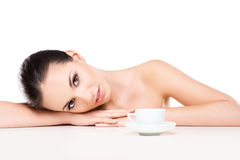 Portrit of a young and naked woman with a cup of coffee Royalty Free Stock Images