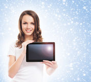 Portrit of a young woman holding a tablet computer Stock Images
