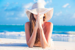 Portrit of young woman in sun hat at beach Royalty Free Stock Photography