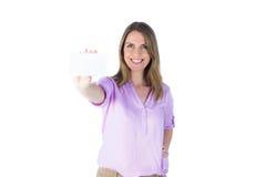 Porträt einer schönen zufälligen Geschäftsfrau, die ein Zeichen zeigt Stockbild