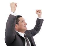 Junger Geschäftsmann, der Erfolg genießt Stockbild