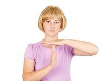 Porträt, Junge, die Frau, die Zeit heraus zeigt, gestikulieren mit Hand-isola Lizenzfreies Stockfoto