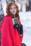 Portrtet young woman with a book. Winter Royalty Free Stock Image