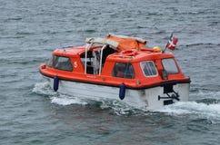 Windsurf Tender returning to the Cruise Ship royalty free stock photo