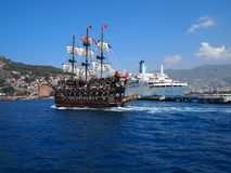 Ports Alanya and Antalya, sea ships for a cruise and travel. The coast of the Mediterranean sea, the port of the city of Alanya, tourist boats and vessels for Royalty Free Stock Photos
