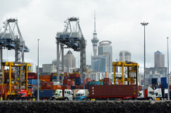 Ports of Auckland - New Zealand. AUCKLAND, NZL -OCT 13 2015:Big cargo ship unloading containers in Ports of Auckland New Zealand.It's New Zealand's stock photography