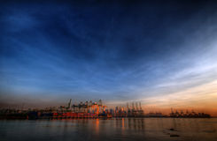 Ports of Singapore. A wideangle view of the ports of Singapore as the sun rises stock photos