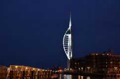 Portsmouth harbour by night. Southcoast, England. With Millennium Spinnaker tower Royalty Free Stock Photo