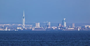 Portsmouth Sea Front With Spinnaker. A view of Portsmouth sea front with the spinnaker tower. Photo taken from the isle of wight royalty free stock images