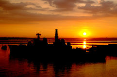 Portsmouth sunset. The sun setting over a royal navy ship docked at Portsmouth harbour in the UK royalty free stock image