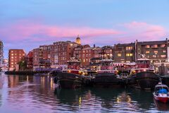 Portsmouth waterfront under colourful sky at dusk