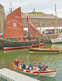 Portsoy Boat Festival 2013. The historic harbor at Portsoy during the 2013 boat festival with crowds lining the sixteenth century pier Royalty Free Stock Photography