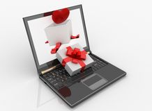 Portátil e caixa aberta para o presente com um coração Imagens de Stock Royalty Free