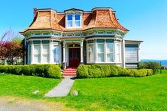 PORTTOWNSEND, WA - APRIL 12, 2014: PortTownsend Historic Building Frank Bartlett hus Royaltyfria Foton
