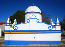 Portugal, Alentejo Region, Evora, Monsaraz. Typical fountain. Portugal, Alentejo Region, Evora, Monsaraz. A typical, old, whitewashed public fountain with blue Stock Photography