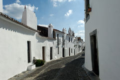 Portugal, Alentejo: village of Monsaraz. Portugal, Alentejo: Magnificent village of Monsaraz; traditional  street with small white houses and red tiles a typical Stock Image
