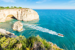 Portugal Algarve beach cave visited by experience boat. Royalty Free Stock Photo