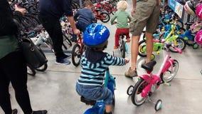 Little  boy in a bike shop Royalty Free Stock Photos