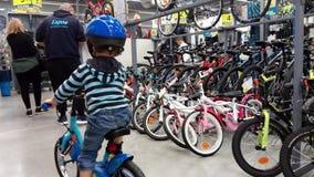 Little  boy in a bike shop Stock Image
