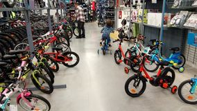 Little  boy in a bike shop Royalty Free Stock Images
