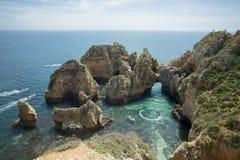 PORTUGAL ALGARVE LAGOS PONTA DA PIEDADE. A landscape at the rocks of Ponta da Piedade near Lagos and Luz at the Algarve of Portugal in Europe stock images