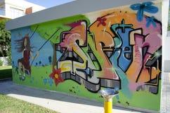 Graffiti in a children`s playground. Portugal, Algarve, Portimao.  Circa 20.10.2013. Graffiti  sprayed on the wall of a building in a children`s playground in Royalty Free Stock Photography