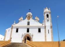 Portugal. Algarve. Portimao. White catholic church on blue sky background. Horizontal view. Stock Images