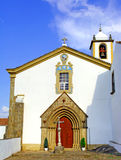 Portugal, area of Alentejo, Marvao: old Church. Portugal, area of Alentejo, Marvao:blue sky and a typical white small Church with a nice stone carved frame door stock images