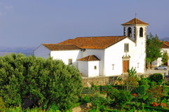Portugal, area of Alentejo, Marvao: old Church. Portugal, area of Alentejo, Marvao: blue sky, green vegetation and a nice white small church on the hill's top; a royalty free stock photos