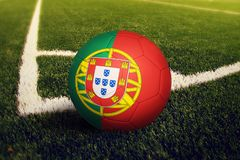 Portugal ball on corner kick position, soccer field background. National football theme on green grass royalty free stock photos