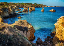 Portugal: beautiful rocks in the coast of Algarve. At sunset royalty free stock images