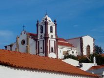 Portugal buildings. In the Algarve, Portugal, Europe. Traditional colorful buildings in the sun with a church Stock Image