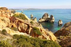 Portugal Coastal Landscape. Amazing colours of sea and cliffs. Portugal Marinha coastal landscape Stock Photos