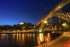 Portugal with the Dom Luiz I bridge atView of the historic city of Porto night time. Travel. Royalty Free Stock Photos