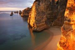 Portugal: Dona Ana beach in Lagos. Dona Ana beach in Lagos, Algarve during sunrise early in the morning Stock Photo