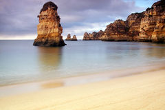 Portugal: Dona Ana beach in Lagos. Dona Ana beach in Lagos, Algarve during sunrise early in the morning Royalty Free Stock Image